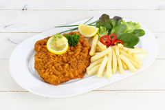 Cutlet with french fries royalty free stock photos