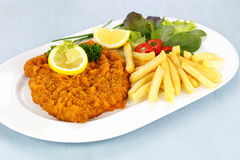 Cutlet with french fries Royalty Free Stock Images