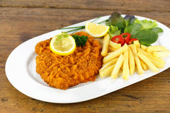 Cutlet with french fries Royalty Free Stock Image