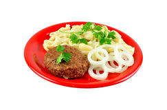 Cutlet fried with macaroni Royalty Free Stock Image