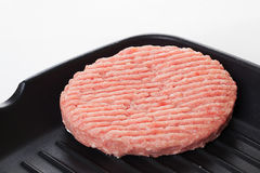 Cutlet in a frying pan raw minced meat, grill. Close-up Stock Photos