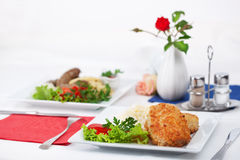 Cutlet with garnish on a table Royalty Free Stock Photo