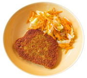 Cutlet with grated carrots on ceramic dish. Stock Photo