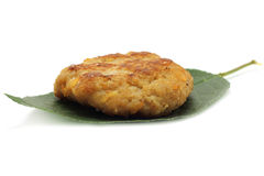 Cutlet on the green leaf. On the white background Royalty Free Stock Photos