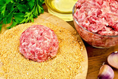 Cutlet homemade and mince meat on the board Stock Photography