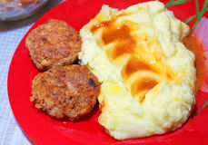 Cutlet with mashed potatoes in sauce Royalty Free Stock Image