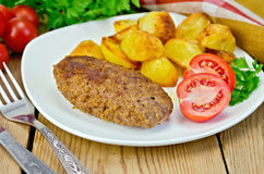 Cutlet meaty with fried potato Royalty Free Stock Photography