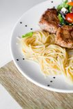 Cutlet and pasta Stock Image
