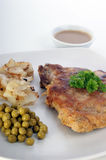 Cutlet with pea and roasted potato Stock Photo