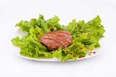 Cutlet on the plate. Cutlet with lettuce on a plate Stock Photos