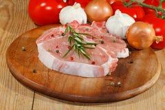 Cutlet, raw, pork, wooden board Royalty Free Stock Photos