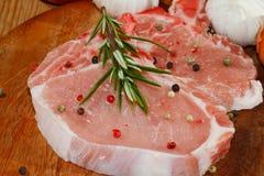 Cutlet, raw, pork, wooden board Stock Photo