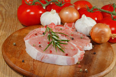 Cutlet, raw, pork, wooden board Stock Photography