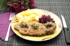 Cutlet with red cabbage Stock Images