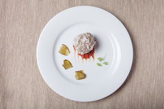Cutlet with rice, slices of pickle and ketchup on white plate on Stock Images