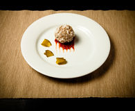 Cutlet with rice, slices of pickle and ketchup on white plate  Royalty Free Stock Images