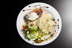 Cutlet with rice and vegetables Stock Images