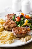 Cutlet and salad Royalty Free Stock Photos