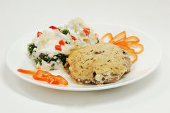 Cutlet with salad. Under mayonnaise Stock Image