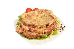 Cutlet with salad and tomato Royalty Free Stock Photo