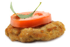 Cutlet and tomato. On the white background Royalty Free Stock Image