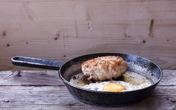 Cutlet with egg. Cutlet from turkey with egg in a frying pan Royalty Free Stock Images