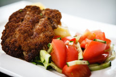 Cutlet with vegetables Royalty Free Stock Photos
