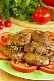 Cutlets. Meat cutlets and tomatoes slices on green plate Stock Photo