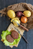 Cutlets of beef, onions and potatoes. Stock Photos