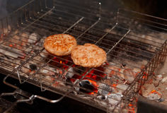 Cutlets being fried on charcoal grill Stock Photos