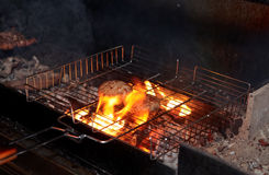 Cutlets being fried on charcoal grill Stock Photo