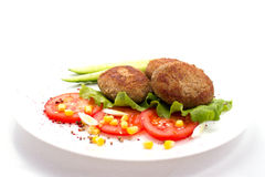 Cutlets breaded with herbs tomatoes Stock Image