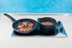 Cutlets and buckwheat cereal in a ware. Ccutlets and buckwheat cereal in a ware with nonstick covering on a glass-ceramic cooktops Stock Photo