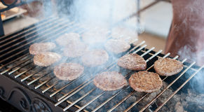Cutlets for burgers are grilled Royalty Free Stock Image