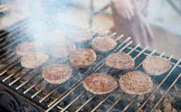 Cutlets for burgers are grilled Stock Photo
