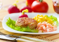 Cutlets with canned corn. Royalty Free Stock Photography