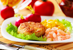 Cutlets with canned corn and shrimp. Royalty Free Stock Photo