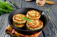 Cutlets. Chicken cutlets with dill. The dish on wooden table Stock Images