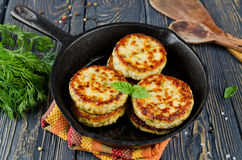 Cutlets. Chicken cutlets with dill. The dish on wooden table Royalty Free Stock Image