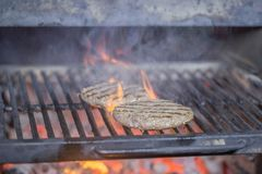 Cutlets cooked in josper amid burning coal for a holiday party royalty free stock photo