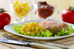 Cutlets with corn and peeled shrimp. Cutlets with canned corn and peeled shrimp Royalty Free Stock Images