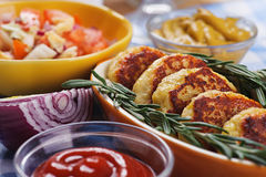 Cutlets with fresh rosemary. On plate located on table Stock Image