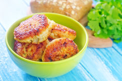 Cutlets. Fried cutlets in green bowl Royalty Free Stock Photos