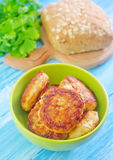Cutlets. Fried cutlets in green bowl Royalty Free Stock Images