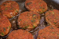 Cutlets fried in a pan. Cutlets are fried in oil in a frying pan Stock Photography