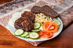 Cutlets with garnish Stock Photography