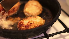 Cutlets for hamburgers are fried in a frying pan in the home kitchen stock video footage