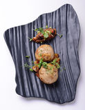 Cutlets of lamb with eggplant on slate board Royalty Free Stock Image
