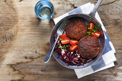 Cutlets from legumes. with salad in a frying pan. for background. Ideas for breakfast or lunch royalty free stock photo
