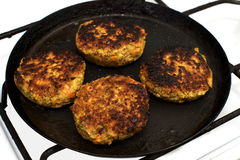 Cutlets from lentils on frying pan royalty free stock photos
